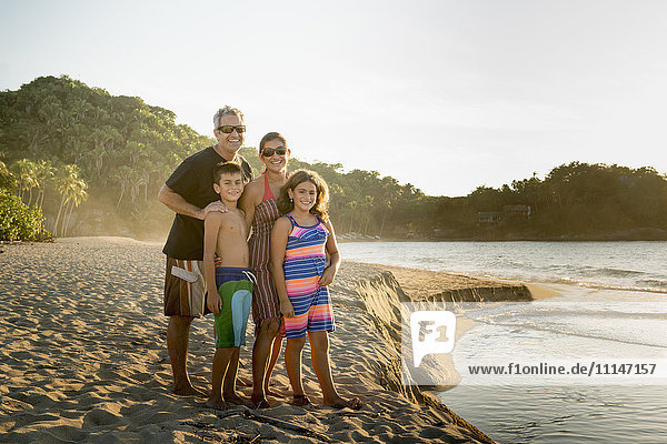 Family standing together on beach