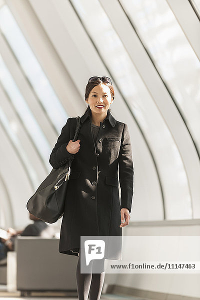 Japanese businesswoman walking in lobby