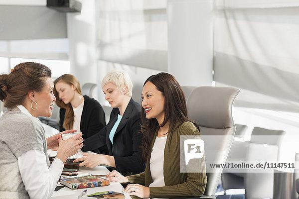 Businesswomen talking in meeting