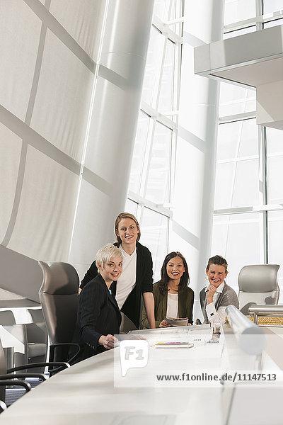 Businesswomen smiling in meeting