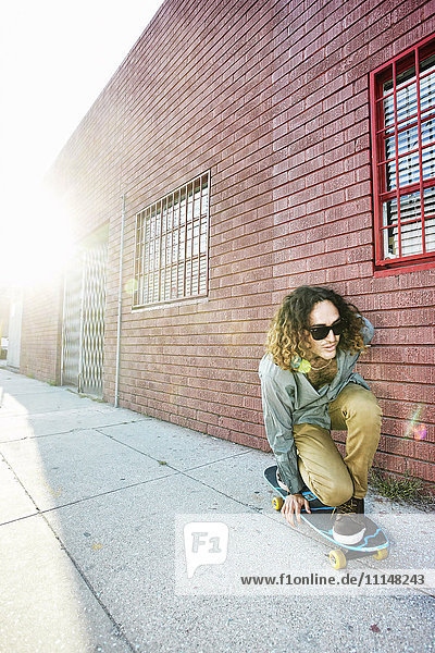 Man riding skateboard on city street Man riding skateboard on city street