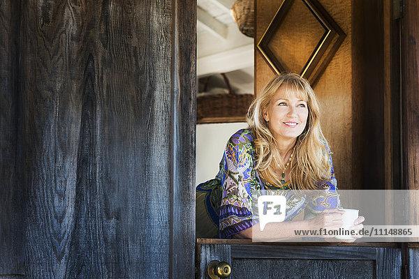 Caucasian woman smiling in doorway Caucasian woman smiling in doorway