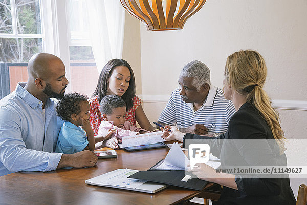 Financial advisor talking to clients