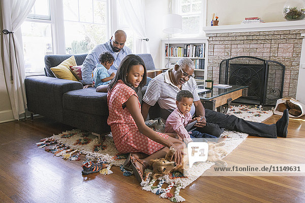 African American family relaxing in living room