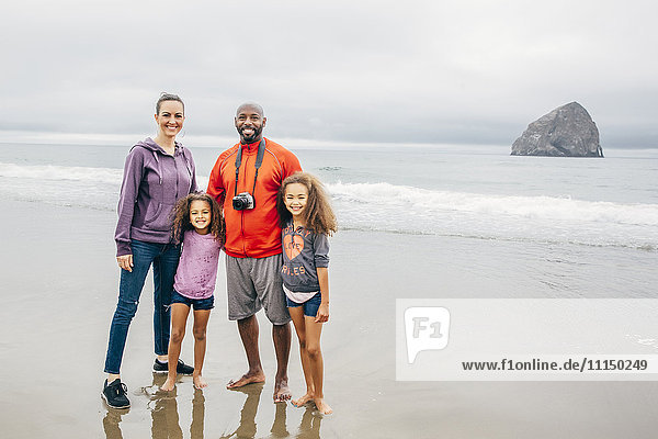Family smiling on beach