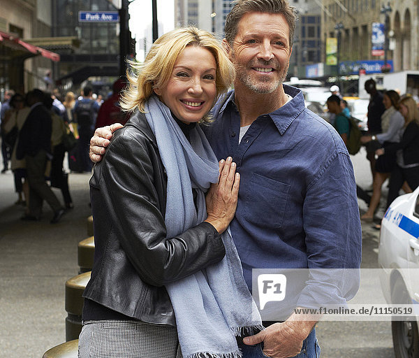 Caucasian couple hugging on city street  New York City  New York  United States