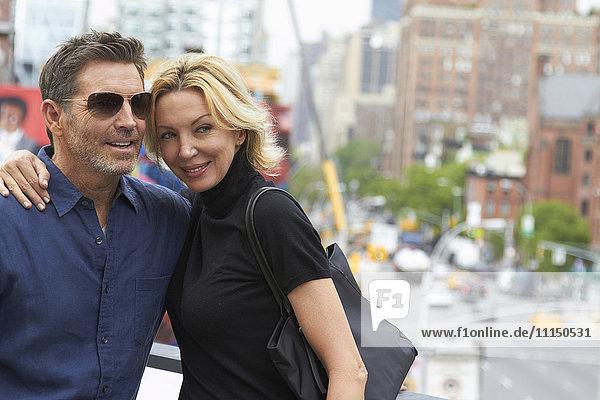 Caucasian couple hugging in city  New York City  New York  United States