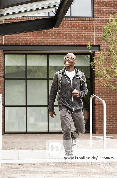 Black man walking in city