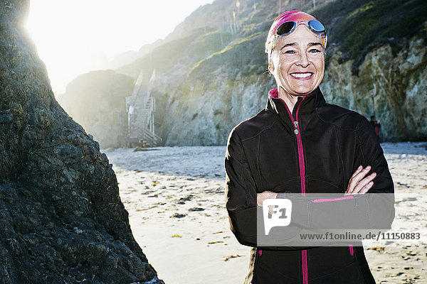 Older Caucasian woman wearing goggles on beach