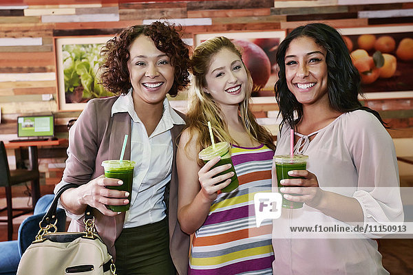 Women having juice together in cafe