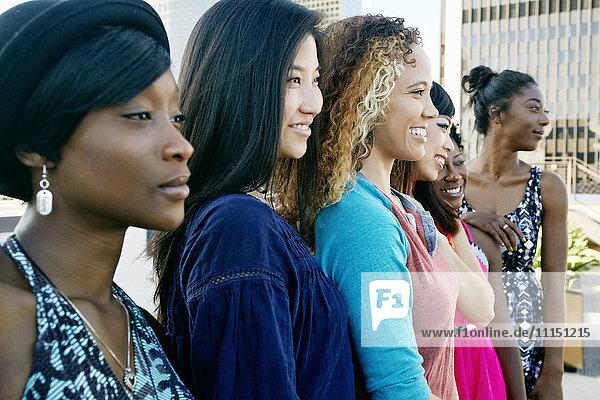 Women smiling on urban rooftop