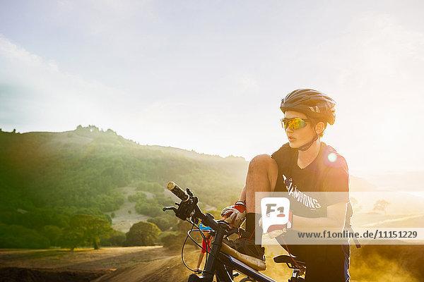 Caucasian boy riding dirt bike outdoors Caucasian boy riding dirt bike outdoors