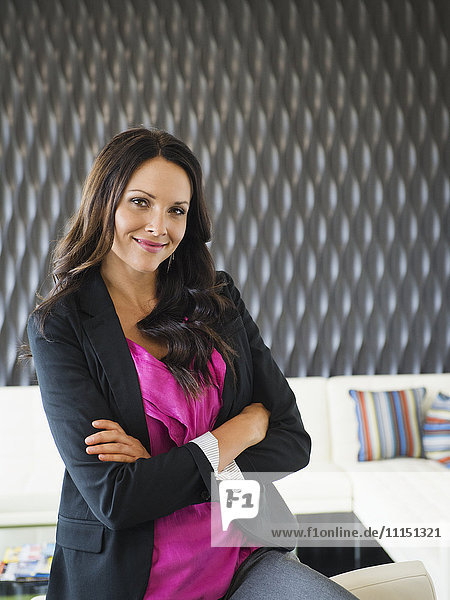 Caucasian businesswoman smiling in office lobby