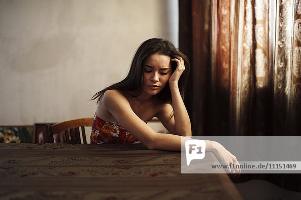 Caucasian woman sitting at table