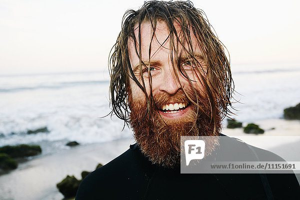 Caucasian surfer with wet hair at beach