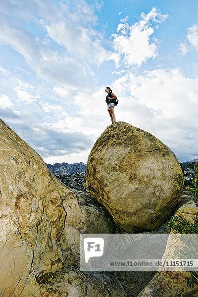 Mixed race woman climbing rock formation Mixed race woman climbing rock formation
