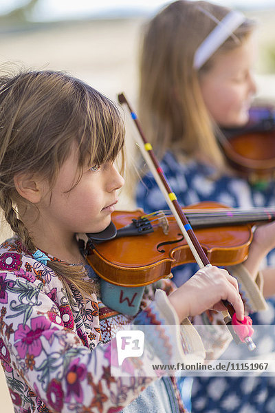 Close up of girls playing violin