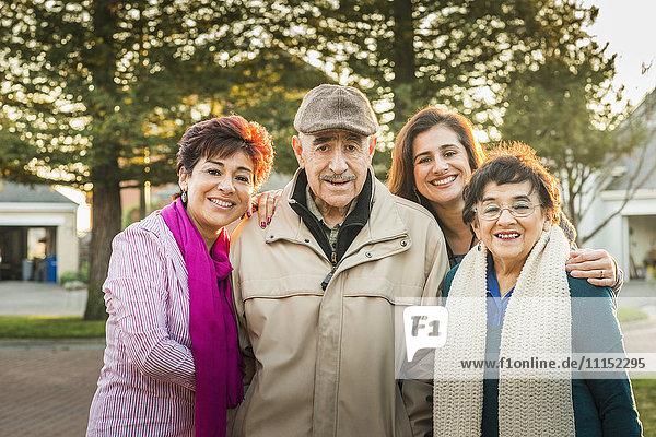 Hispanic Multi-generation family smiling outdoors
