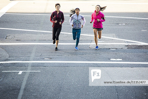 High angle view of women running in city street