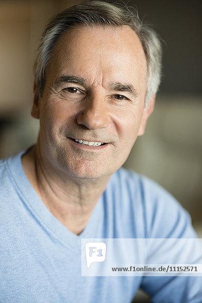 Close up of older Caucasian man smiling