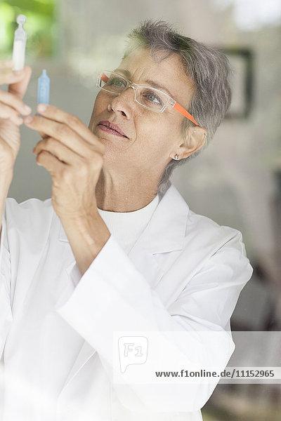 Close up of doctor examining vials