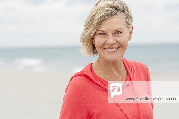Older Caucasian woman smiling on beach