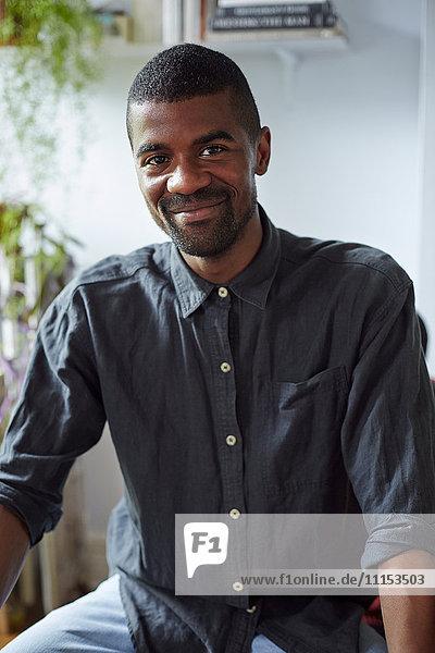 Close up of Black man smiling indoors