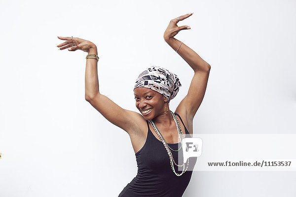 Black woman posing with arms raised
