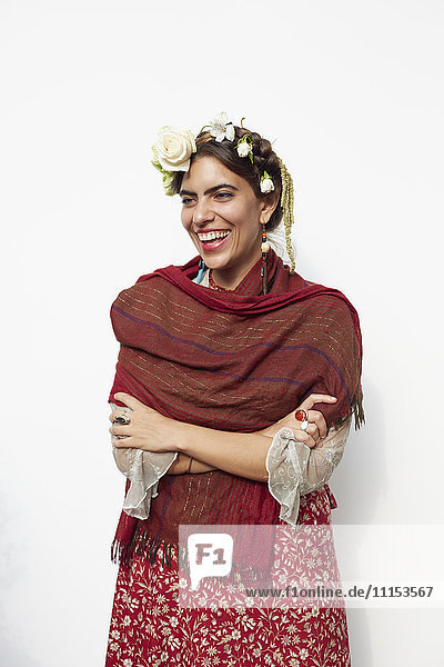 Stylish woman wearing shawl and flowers in hair