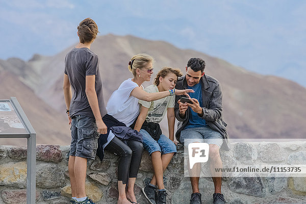 Family using cell phone at national park
