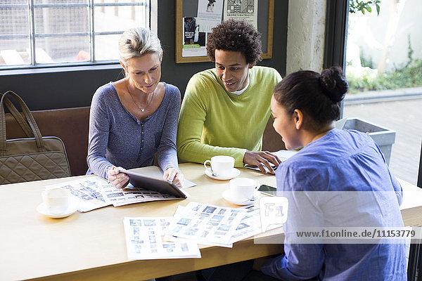 Business people using digital tablet in office meeting