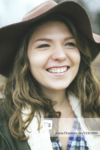 Smiling Caucasian woman wearing sun hat