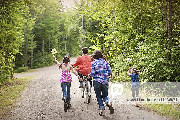 Three generations of Caucasian women walking on dirt road