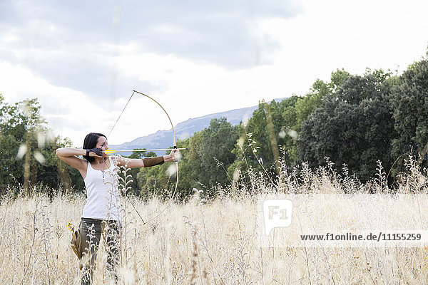 Archeress aiming with her bow