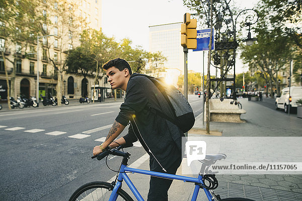 Teenager with a bike in the city
