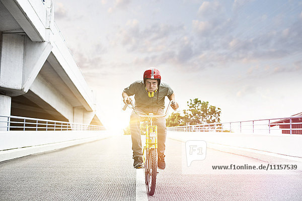 Teenage boy speeding up on bicycle