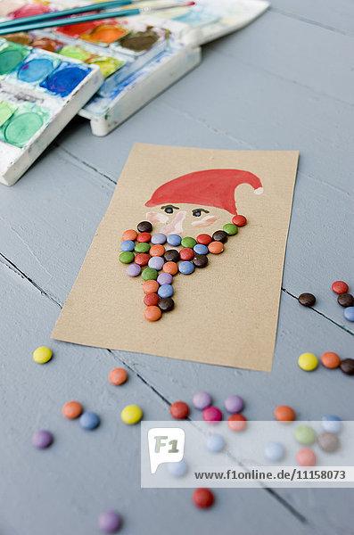 Weihnachtskarte aus Wasserfarben und Schokoladentropfen