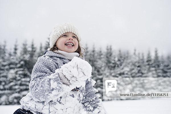 Happy girl in winter landscape
