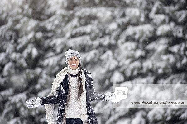 Portrait of smiling woman in winter landscape
