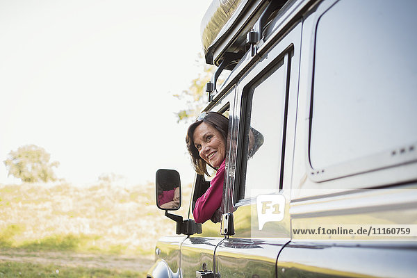 Senior woman on a trip in a cross country vehicle