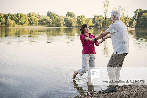 Happy senior couple at a lake