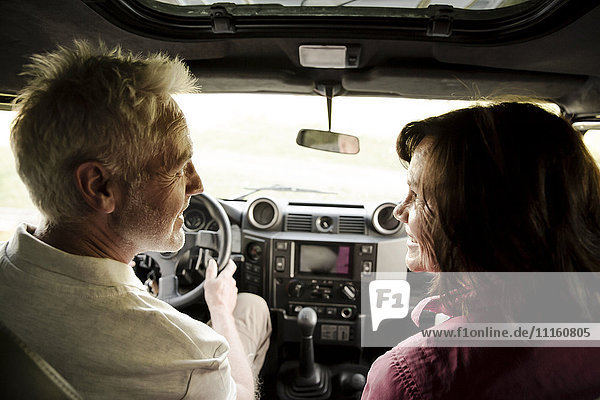 Senior couple on a trip in a cross country vehicle