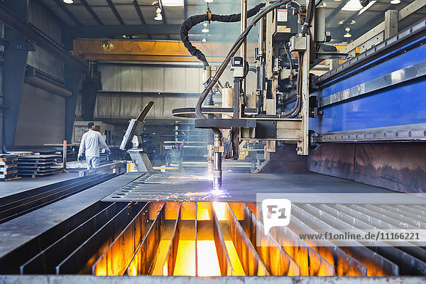 Machinery fabricating metal in factory