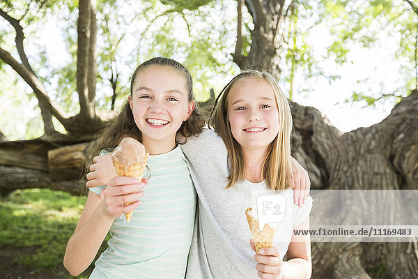 Caucasian girls eating ice cream cones