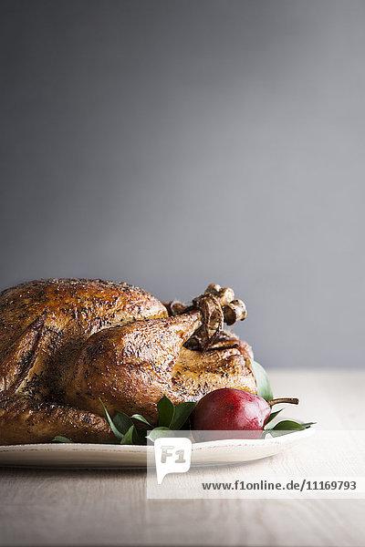 Pear on plate with cajun turkey
