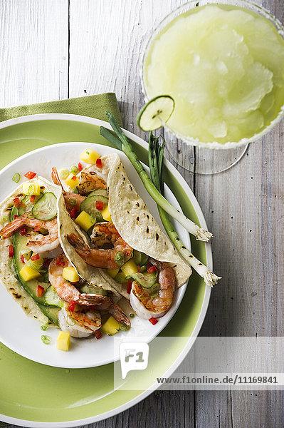 Shrimp tacos and frozen margarita