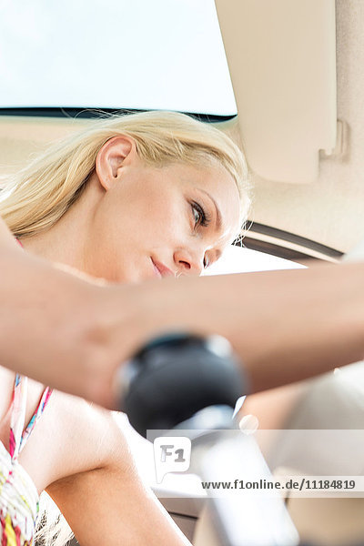 Low angle view of woman sitting in car