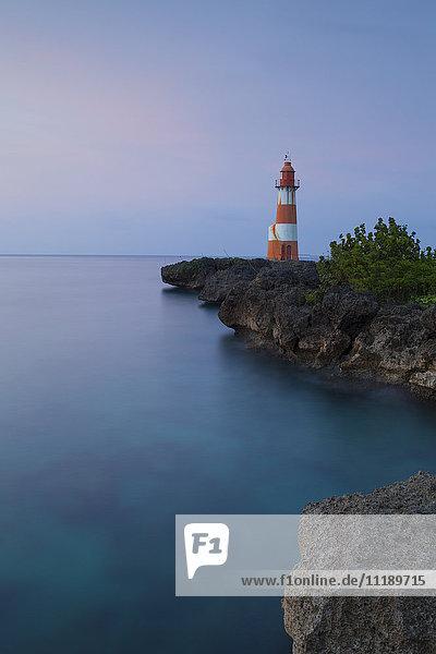 Folly Point Lighthouse illuminated at dusk  Port Antonio  Portland Parish  Jamaica  Caribbean