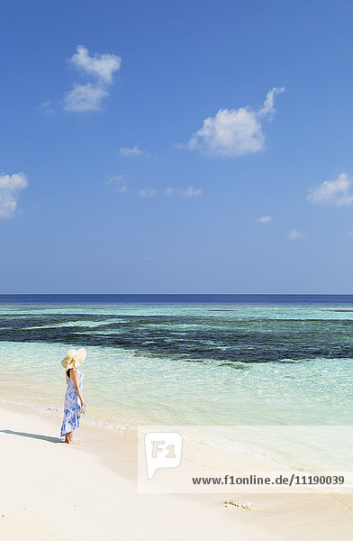 Woman on beach  Rasdhoo Island  Northern Ari Atoll  Maldives (MR)