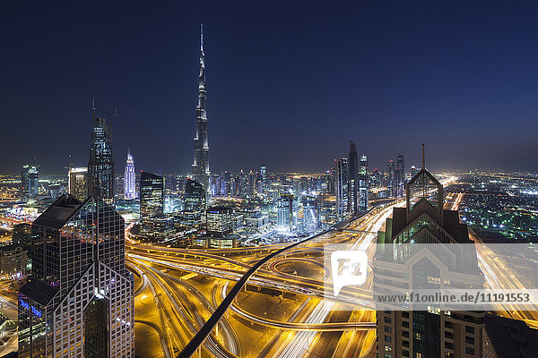 UAE  Dubai  Downtown Dubai  eleavted view over Sheikh Zayed Road and Burj Khalifa Tower  world's tallest building  2016  dusk